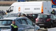 Police officers and and Sedee-Dovo, the mine clearance service of Belgian defence, patrol in Antwerp where Belgian police arrested a man on March 23, 2017 . (VIRGINIE LEFOUR/AFP/Getty Images)
