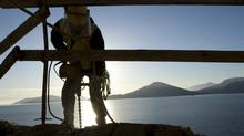 A construction worker on the Sea to Sky Highway in B.C. in January of 2008. (JOHN LEHMANN/JOHN LEHMANN/GLOBE AND MAIL)