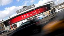 A Tesla car showroom is seen in west London, Britain, on March 21. (Toby Melville/Reuters)