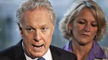 Quebec Liberal Party Leader Jean Charest alongside candidate Lise Theriault, responds to reporters questions at a news conference during a campaign stop in Quebec City, Sunday, August 12, 2012. (Jacques Boissinot/THE CANADIAN PRESS)