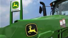 Deere equipment is on display at the Farm Progress Show in Decatur, Ill. (Seth Perlman/AP)