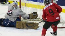 Canada forward Hunter Shinkaruk (9) gets stopped by CIS Toronto Selects goalie Garrett Sheehan, left, during first period exhibition hockey action at the world Juniors selection camp in Toronto on Saturday, Dec. 14, 2013. (Nathan Denette/THE CANADIAN PRESS)