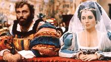 "Elizabeth Taylor and Richard Burton kneel in a scene from the 1967 film ""The Taming of the Shrew"" in Italy. (Getty Images/Getty Images)"