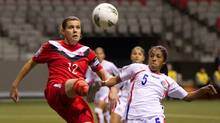 Canada's Christine Sinclair, left, and Costa Rica's Diana Saenz battle for the ball during the first half of play in a CONCACAF women's Olympic qualifying soccer game in Vancouver, B.C., on Monday January 23, 2012. (DARRYL DYCK/THE CANADIAN PRESS)