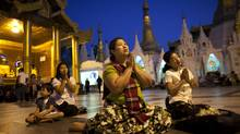 Devotees pray at Myanmar's holiest Buddhist site, the Shweddagon Pagoda in Rangoon. (Adam Dean for The Globe and Mail/Adam Dean for The Globe and Mail)