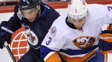 Winnipeg Jets' Evander Kane (L) battles for the puck with New York Islanders' Travis Hamonic during the first period of their NHL hockey game in Winnipeg December 20, 2011. REUTERS/Fred Greenslade (Fred Greenslade/Reuters)