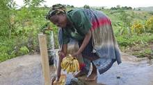 A woman draws water from a tap installed in her village as part a Canadian-funded aid project aimed at preventing cholera in Malawi in 2009. (Erin Conway-Smith/Erin Conway-Smith for The Globe and Mail)