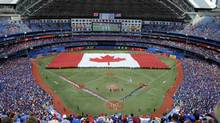 A general view as a Canadian flag is unfurled across the outfield for Canada Day before the game between the Milwaukee Brewers and Toronto Blue Jays at Rogers Centre. (Peter Llewellyn/USA Today Sports)