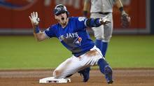 Toronto Blue Jays third baseman Josh Donaldson (20) reacts after hitting a double against the Texas Rangers during tenth inning game three American League Division Series action in Toronto on Sunday, October 9, 2016. Donaldson will likely miss the first couple of weeks of spring training with a right calf strain. (Nathan Denette/THE CANADIAN PRESS)