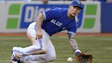 Toronto Blue Jays third baseman Brett Lawrie fields a ground ball hit by Oakland Athletics batter Jemile Weeks during the second inning of their game Tuesday. (MIKE CASSESE/REUTERS)