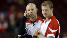 Team Canada skip Pat Simmons and second Carter Rycroft look on during their draw against Team Newfoundland and Labrador at the Brier curling championships in Ottawa, Canada, March 9, 2016. (CHRIS WATTIE/REUTERS)