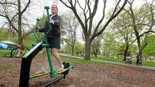 Beata Reitner tries out an elliptical machine at an outdoor workout station alongside the Woodbine Beach playground in Toronto Monday May 23, 2011. (Tim Fraser for The Globe and Mail/Tim Fraser for The Globe and Mail)