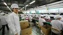 A Foxconn factory in the township of Longhua: Foxconn is China's biggest private-sector employer and Apple's main contract manufacturer. (Bobby Yip/Reuters/Bobby Yip/Reuters)