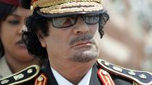 Libyan leader Moammar Gadhafi arrives in Rome on June 10, 2009. (RICCARDO DE LUCA/AP)