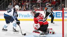 Patrik Laine #29 of the Winnipeg Jets skates with the puck on his way to scoring the game winning goal during the shootout against Cory Schneider #35 of the New Jersey Devils on March 28, 2017. (Christopher Pasatieri/Getty Images)