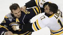 Buffalo Sabres' Paul Gaustad (28) and Boston Bruins' Milan Lucic (17) fight during the first period of an NHL hockey game at the First Niagara Center in Buffalo, N.Y., Friday, Nov. 23, 2011. (AP Photo/Derek Gee) (Derek Gee/AP)