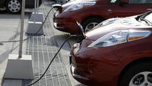 Electric Nissan Leaf, belonging to rent a car company Autoshare, can be seen while charging batteries at Brickworks on Bayview Ave., Toronto October 25, 2011. (Fernando Morales/The Globe and Mail)