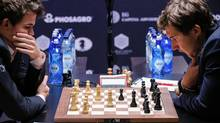 Russian chess grandmaster Sergey Karjakin, right, plays Magnus Carlsen, Norwegian chess grandmaster and current World Chess Champion, on Nov. 28, 2016 in New York during Round 12 of the World Chess Championship. (Kena Betancur/AFP/Getty Images)