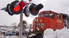 A CN locomotive moves in the railway yard in Dartmouth, N.S. (Andrew Vaughan/THE CANADIAN PRESS)