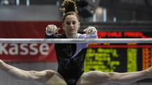 Kristina Vaculik of Canada performs to win on uneven bars during the gymnastics World Cup in Cottbus, Germany, Saturday, March 13, 2010. (AP Photo/dpad/Matthias Rietschel) (Matthias Rietschel)