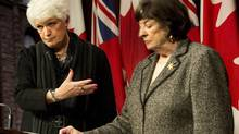 Ontario Education Minister Liz Sandals, left, and education consultant Margaret Wilson hold a news conference at Queen's Park in Toronto Thursday. (Nathan Denette/THE CANADIAN PRESS)