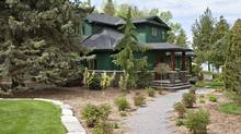 The house on Lake Simcoe is predominantly timber clad and painted a subdued green but from the midriff down it wears a rugged dry stone skirt. (Andrew Filarski/Andrew Filarski)