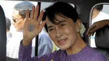 Myanmar pro-democracy icon Aung San Suu Kyi waves to her supporters on her way to Kaw-Hmu constituency for upcoming election campaign, in Yangon, Myanmar. (Khin Maung Win/AP)