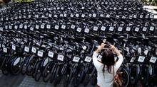 Bixi has 500 people working in its bike-share programs, which started with Washington and Melbourne, Australia. (DARRYL DYCK For The Globe and Mail)