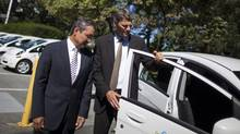 Vancouver Mayor Gregor Robertson, right, and Shin Fujioka, CEO of Mitsubishi Motor Sales of Canada, look over one of the city's new Mitsubishi i-MiEVs electric vehicles at City Hall on Wednesday. (Rafal Gerszak for The Globe and Mail)