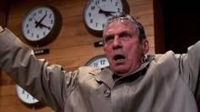 Peter Finch as Howard Beale in Network