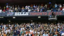 Fans stand for the national anthem before the Indianapolis Colts and Buffalo Bills preseason NFL game in Toronto in 2010. (Mike Groll/AP)