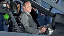Defence Minister Peter MacKay checks out the cockpit of the F-35 Joint Strike Fighter in Ottawa on July 16, 2010. (Adrian Wyld/Adrian Wyld/The Canadian Press)