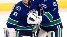 Vancouver Canucks' goalies Cory Schneider, left, and Roberto Luongo (DARRYL DYCK/The Canadian Press)