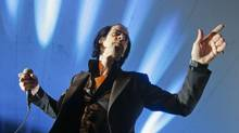 Nick Cave (seen here at SXSW in Austin, Tex.) with the Bad Seeds cemented his status as one of rock's most explosive live acts. (Jack Plunkett/AP)