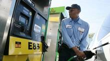 A driver tanks up at an ethanol fuel station in the Los Angeles area. (J. EMILIO FLORES/AFP/Getty Images)