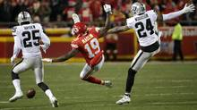 Kansas City Chiefs wide receiver Jeremy Maclin, centre, is injured against the Oakland Raiders on Jan. 3. Maclin also sustained a sprained ankle in the Chiefs Wild Card win over the Houston Texans. (Charlie Riedel/AP Photo)