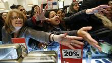 Shoppers beg sales assistants for perfume products in Selfridges on the morning of the Boxing Day sales in London Dec. 26, 2012. (OLIVIA HARRIS/Reuters)