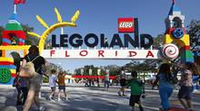 Park visitors enter Legoland Florida during its grand opening celebration in Winter Haven, Oct. 14, 2011. (PIERRE DUCHARME/REUTERS)