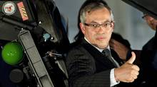 Minister of Industry Tony Clement gives the thumbs up as he sits in the cockpit of the F-35 Joint Strike Fighter following an announcement in Ottawa, Friday July 16, 2010. (Adrian Wyld/THE CANADIAN PRESS)