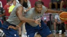 Team USA guard Kevin Durant dribbles the ball against guard James Harden (Stephen R. Sylvanie)