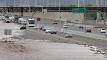 This Aug. 19, 2014 file photo shows flash flood waters from the overrun Skunk Creek flood I-10 in northwestern Phoenix. (Matt York/Associated Press)