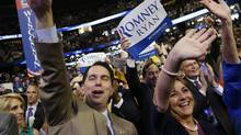 Wisconsin Governor Scott Walker and his wife,Tonette, cheer as Republican vice presidential nominee, Representative Paul Ryan addresses the Republican National Convention in Tampa, Fla., Aug. 29, 2012. (David Goldman/AP)