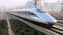 In this photo released by China's Xinhua news agency, a high-speed train leaves for Beijing from Shijiazhuang, Dec. 26, 2012. (Wang Xiao/AP)