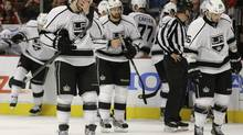 Los Angeles Kings defenseman Drew Doughty (8), right wing Justin Williams (14) and defenseman Slava Voynov (26) react late in the third period against the Chicago Blackhawks during Game 2 of an NHL hockey Stanley Cup Western Conference finals, Sunday, June 2, 2013, in Chicago. The Blackhawks won 4-2. (Nam Y. Huh/AP)