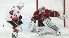 Minnesota Wild goaltender Alex Stalock watches the puck after making a save in the third period of an NHL hockey game against the Ottawa Senators in St. Paul, Minn., on March 30, 2017. (Stacy Bengs/AP)