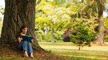 Reading outdoors is one of the pleasures of the Canadian summer. (Michelle Milliman/Getty Images/iStockphoto)