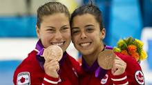 Canadian divers Roseline Filion, left, and Meaghan Benfeito celebrate after winning their bronze medals in women's synchronized 10m platform at the 2012 Summer Olympic Games in London, England Tuesday, July 31, 2012. (Kevin Van Paassen/The Globe and Mail)