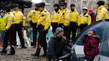 "Police walk through St. James park after they moved in to evict protesters as a woman yells from her tent during the ""Occupy Toronto"" movement in Toronto, November 23, 2011. (MARK BLINCH/Mark Blinch/REUTERS)"