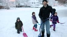 December 21, 2012: Stay at home dad Yariv Wolfe out shoveling the drive way after a storm with his children Ma'ayan 8, Tzipi 6, Ari 3 in Ottawa. (Dave Chan for The Globe and Mail)