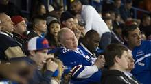 Toronto Mayor Rob Ford, middle, and his driver Jerry Agyemang, right, attends the Buffalo Bills versus Atlanta Falcons NFL game at the Rogers Centre in Toronto on Dec. 1, 2013. (PHILIP CHEUNG FOR THE GLOBE AND MAIL)